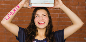 Photo of college-aged girl holding textbooks