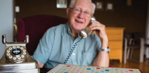 Photo of elderly man talking on the telephone