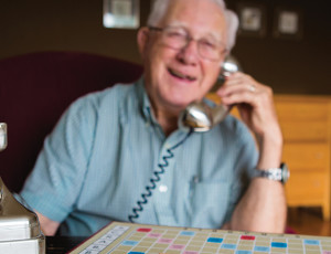 Photo of elderly man talking on the telephone