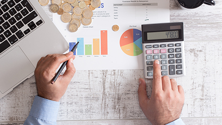 photo of person making financial calculations